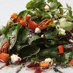 Spinach and watercress salad with a Hibiscus flower vinaigrette.