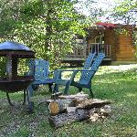 Fire pit and chairs next to the cabin.