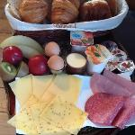Typical breakfast, fresh bread, meat and cheeses, delicious.