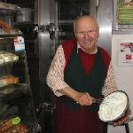 Umberto proudly whipping fresh cream