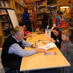 Children's authors visit, speak with, and sign books for the kids