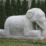 One of many stone statues of people and animals on the grounds