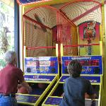 Arcades for kids and adult kids is located near pool
