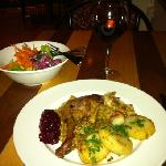 Duck Confit accompanied by salad