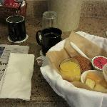 Breakfast basket, with muffin, yogurt, fruit, juice and coffee