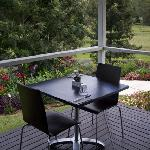 Dining on the verandah, with views of the beautiful gardens and surrounding countryside.