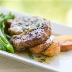 Grain Fed Rib Fillet, Crispy Chat Potatoes, Beans and Broccolini served with Herbed Butter and P