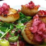 panseared scallops over fava bean, pea tendril salad with a ramp relish