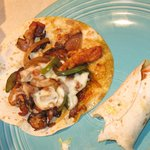 The Alhambre - three flour tortillas with grilled chicken & bacon with sauteed green peppers & o