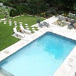 Heated inground pool with loungers
