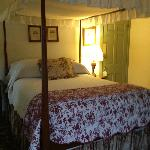 The queen canopy bed in Room 6