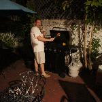 Neil (property manager) grilling some bell peppers in the courtyard