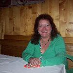 My guest Rosa in our booth; portions of walls and ceiling are paneled wood