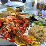 Plato Mixto for 2 - Fish, lobster, conch, shrimp, coconut rice, and patacones