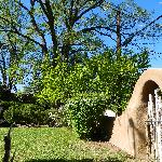 Lovely adobe walls with archways surround property.