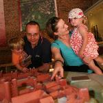 A family enjoys the model of Basing House in the visitor centre
