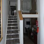 Stairs up to bedroom, down to living area