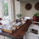 breakfast table overlooking the pool and opened up for tea time
