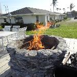 fire/bbq pit on patio area by beach
