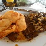 Typical Panamanian breakfast at Mi Ranchita.  Fried bread with calves liver in salsa and onions.