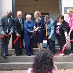 Dignitaries cut the ribbon as Massie opens the doors for the Grand Re-Opening.