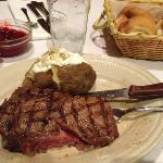 One of the steaks cooked deliciously rare and those yeast rolls!
