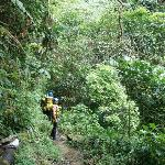 Hiking to the river head for water canyoning