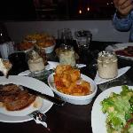feather steak, salad, millionaire fries, etc.