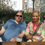 My husband and me enjoying a drink in the garden area