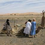 Mounting camels outside the hotel