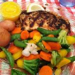 Cajun style snapper with new potatoes, fresh steamed veggies