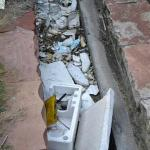 debris -trash next to the pool