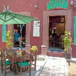 There are four table street side and four inside. Small place but quite comfortable.