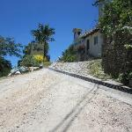 The entrance to the hotel from a steep dirt road; hope it doesn't rain during your stay;