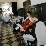 string trio serenading the ladies before the tea