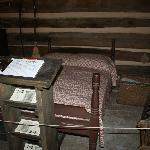 Old timey bed inside the Ogle Log Cabin. Also a guest book for your name & town your from.