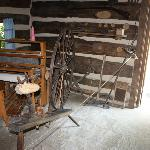 Inside the Ogle Log Cabin. Spinning Wheel.
