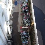 Shopping trolleys of rubbish under stairs
