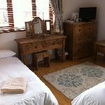 spacious room with a king size bed and a fold up bed