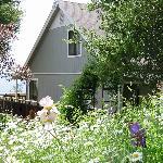 Flower gardens & gravel pathways surround the lodge.