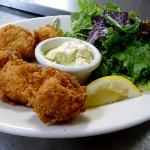 Our tender, yet crispy, buttermilk fried sea scallops with remoulade and a mixed greens house sa
