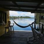 Hammock and seating area on front porch of cabin