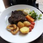 Well Done Sirloin Steak with veg onion rings and chips