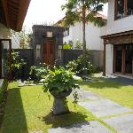 entrance with dining on one side and 2 story 4 bedroomed villa on the other..