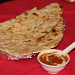 Grarlilick Naan  with curry   it is very  good  tast