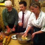 Hotel Owner, Chris & His Assistant with VBT Bikers During Cooking Demonstration