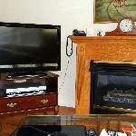 Our flat-screen hd tv and fireplace