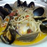 Mussels and clams pasta with saffron broth