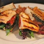 Special Grilled Salmon Club with Applewood Smoked Bacon and Roasted Tomatoes.