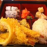 shrimp tempura bento box serve with bowl of soup an salad and a free drink